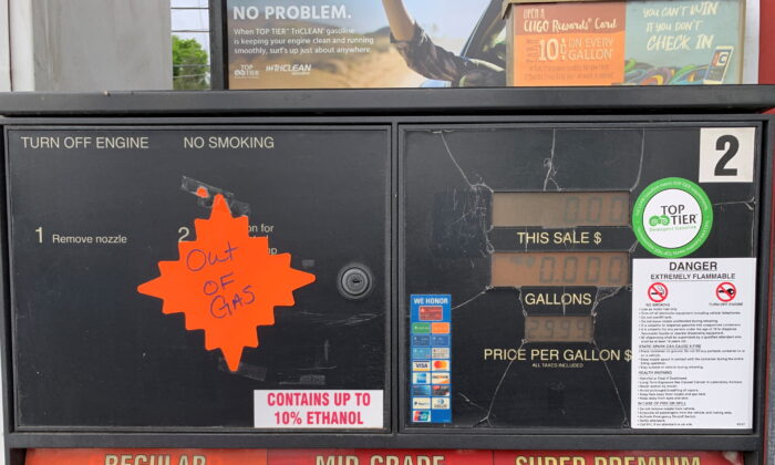 """An """"out of gas"""" sticker is seen on a gas pump at a gas station after a gasoline supply crunch caused by the Colonial Pipeline hack, in Waynesville, N.C., on May 11, 2021. (Martin Brossman via Reuters)"""