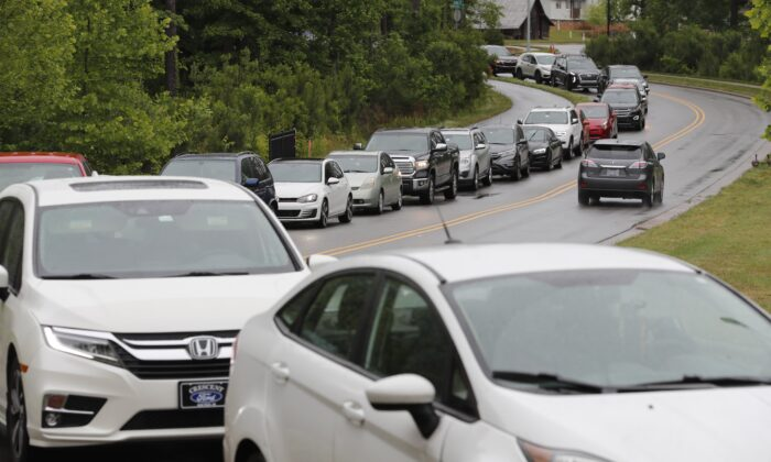 Cars line up on Pine Plaza Drive for gas at the Costco in Apex, N.C., on May 12, 2021. (Ethan Hyman/The News & Observer via AP)