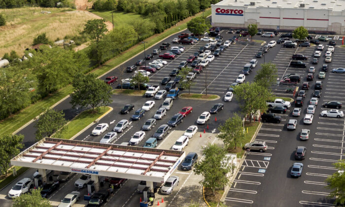 In this aerial image taken with a drone, numerous vehicles line up for gasoline at Costco on Wendover Avenue in Greensboro, N.C., on, May 11, 2021. (Woody Marshall/News & Record via AP)