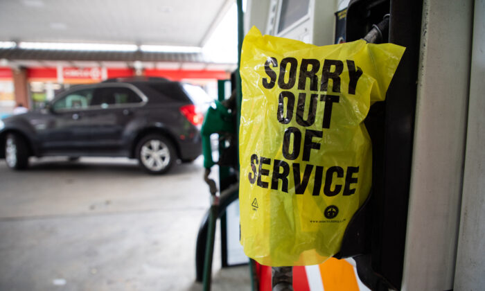 """An """"Out Of Service"""" bag covers a gas pump at a station in Charlotte, N.C., on May 11, 2021. (Logan Cyrus/AFP via Getty Images)"""