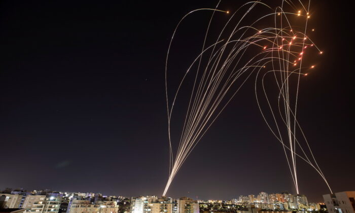 Streaks of light are seen as Israel's Iron Dome anti-missile system intercepts rockets launched from the Gaza Strip towards Israel, as seen from Ashkelon, Israel, May 11, 2021. (Nir Elias/Reuters)