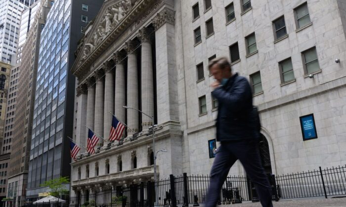 A man walks past the New York Stock Exchange on Wall Street in New York on May 10, 2021. (Angela Weiss/AFP via Getty Images)