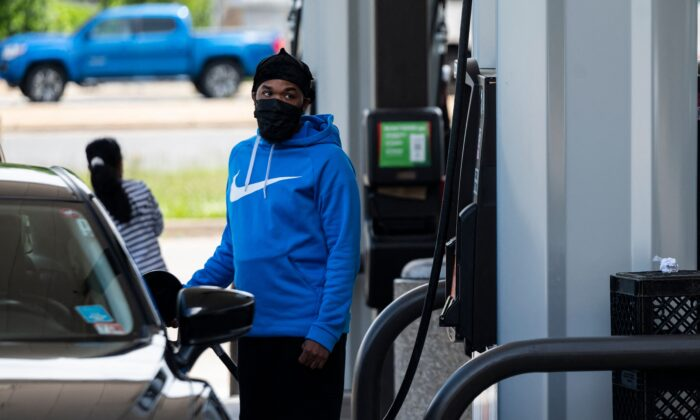 A motorist fills up at a gas station in Woodbridge, Va., on May 12, 2021. (Andrew Caballero-Reynolds/AFP via Getty Images)