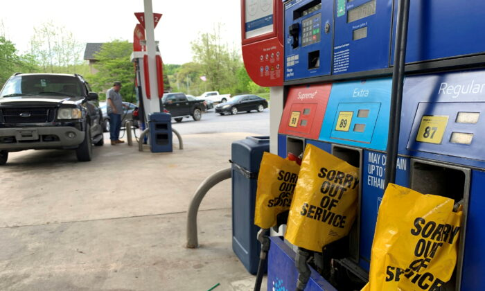 Out of service fuel nozzles are covered in plastic on a gas pump at a gas station in Waynesville, N.C., on May 11, 2021. (Martin Brossman via Reuters)