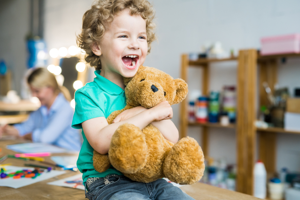 Warm,Toned,Portrait,Of,Happy,Curly,Haired,Kid,Laughing,Cheerfully