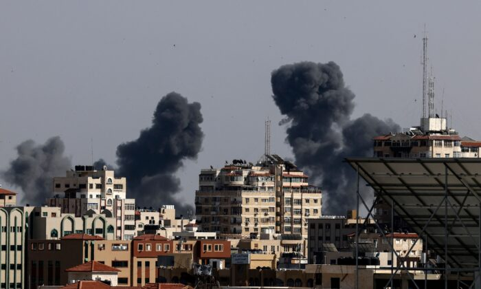 Smoke billows from Israeli air strikes in the Gaza Strip on May 11, 2021. (Mahmud Hams/AFP/Getty Images)