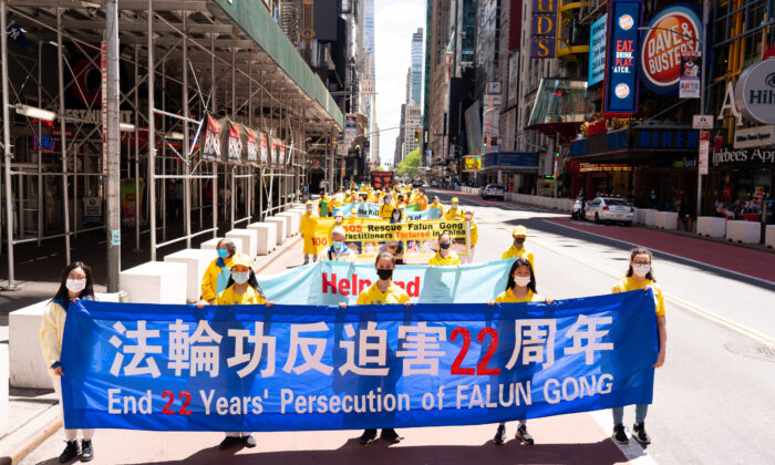 Practitioners of the spiritual discipline Falun Gong hold a parade in New York to celebrate World Falun Dafa Day and to protest the ongoing persecution of the group by the Chinese Communist Party in China, on May 13, 2021. (Larry Dai/The Epoch Times)