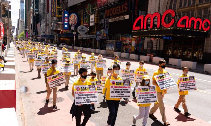 Practitioners of the spiritual discipline Falun Gong hold a parade in New York to celebrate World Falun Dafa Day and to protest the ongoing persecution of the group by the Chinese Communist Party in China, on May 13, 2020. (Larry Dai/The Epoch Times)