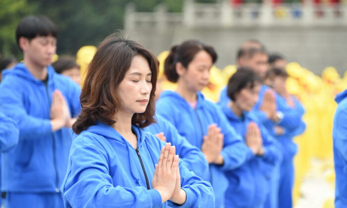 Falun Gong adherents perform the exercises at an event celebrating World Falun Dafa Day in Taipei, Taiwan, on May 1, 2021. (Sun Hsiang-yi/The Epoch Times)