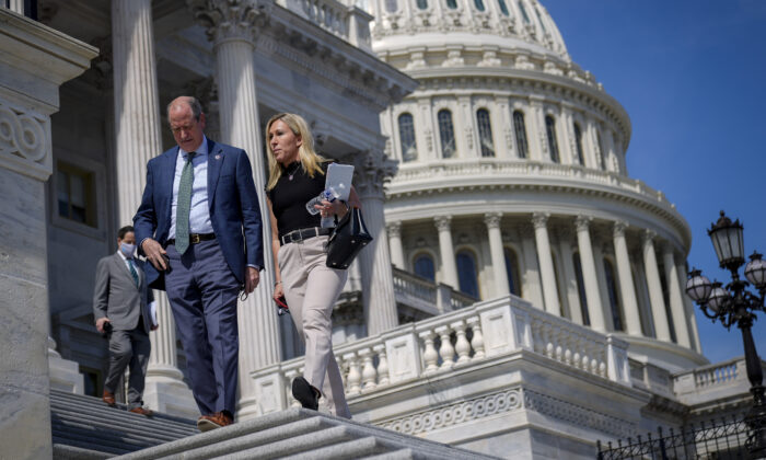 Rep. Dan Bishop (R-NC) talks with Rep. Marjorie Taylor Greene (R-GA) on the House steps at the U.S. Capitol in Washington, D.C., on March 11, 2021. (Drew Angerer/Getty Images)