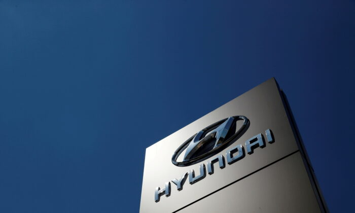 A shop sign of Hyundai is seen outside a car showroom in Bletchley, Milton Keynes, Britain, May 31, 2020. (Andrew Boyers/Reuters File Photo)