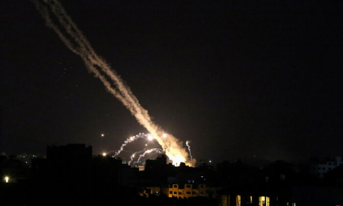Rockets are launched by Palestinian terrorists into Israel, in Gaza, on May 13, 2021. (Ibraheem Abu Mustafa/Reuters)