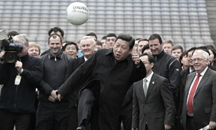 Then Chinese deputy leader Xi Jinping (C) kicks a Gaelic football as he visits at Croke Park in Dublin, Ireland on Feb. 19, 2012. (Peter Muhly/AFP/Getty Images)