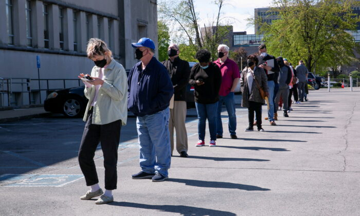 People line up outside a newly reopened career center for in-person appointments in Louisville, Ky., on April 15, 2021. (Amira Karaoud/Reuters)