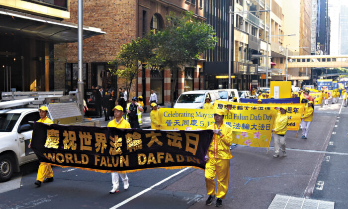 Falun Gong practitioners participating in a rally and parade in the CBD of Sydney, Australia on May 13, 2021.  (Shen Ke/The Epoch Times)