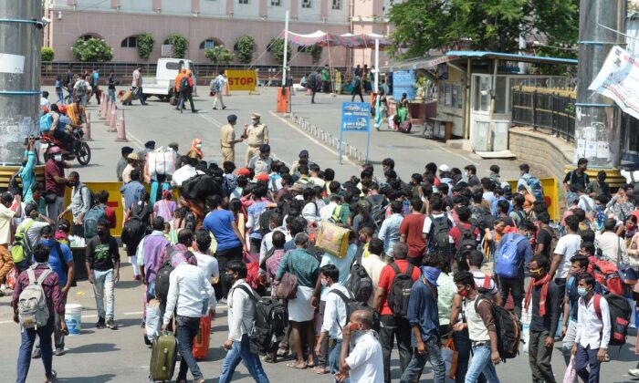 People wait in line outside a railway station to return home during the first day of a government imposed 10-day lockdown to curb the spread of COVID-19 in Secunderabad, India, on May 12, 2021. (Noah Seelam/AFP via Getty Images)