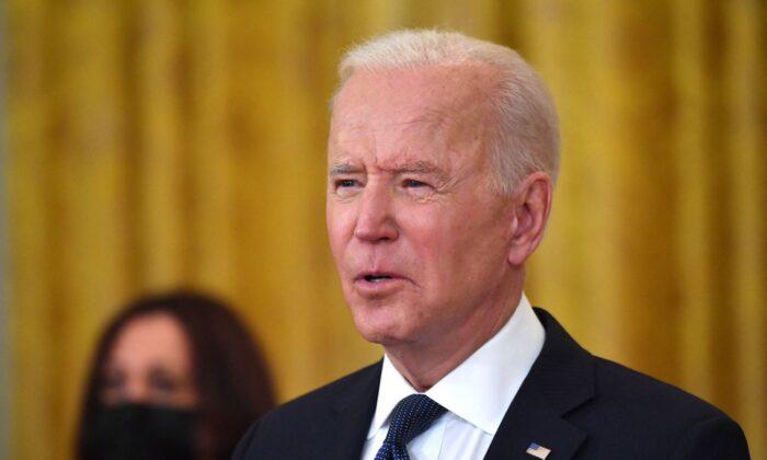 Vice President Kamala Harris (L) listens as President Joe Biden speaks at the White House on May 10, 2021. (Nicholas Kamm/AFP via Getty Images)