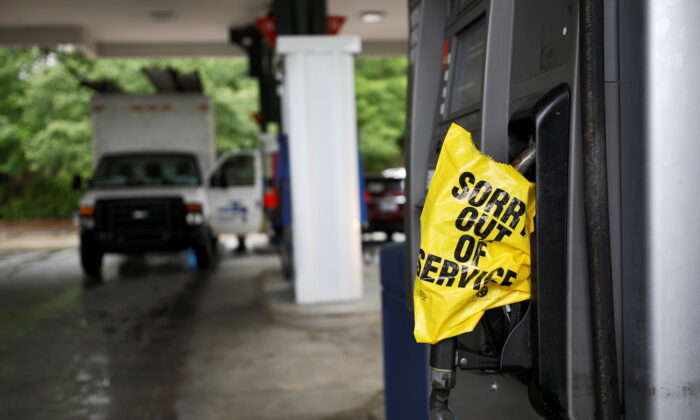 A bagged nozzle at a pump notifies motorists that it no longer has fuel after a cyberattack crippled the biggest fuel pipeline in the country, run by Colonial Pipeline, in Chapel Hill, N.C., on May 12, 2021. (Jonathan Drake/Reuters)
