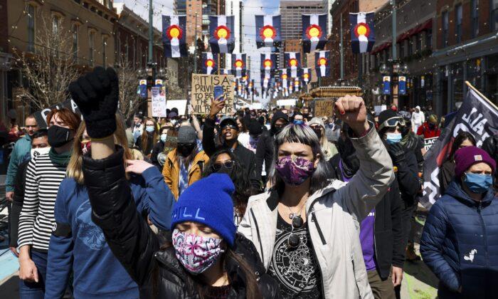 Protesters march through Larimer Square in Denver, Colo., on April 17, 2021. (Michael Ciaglo/Getty Images)
