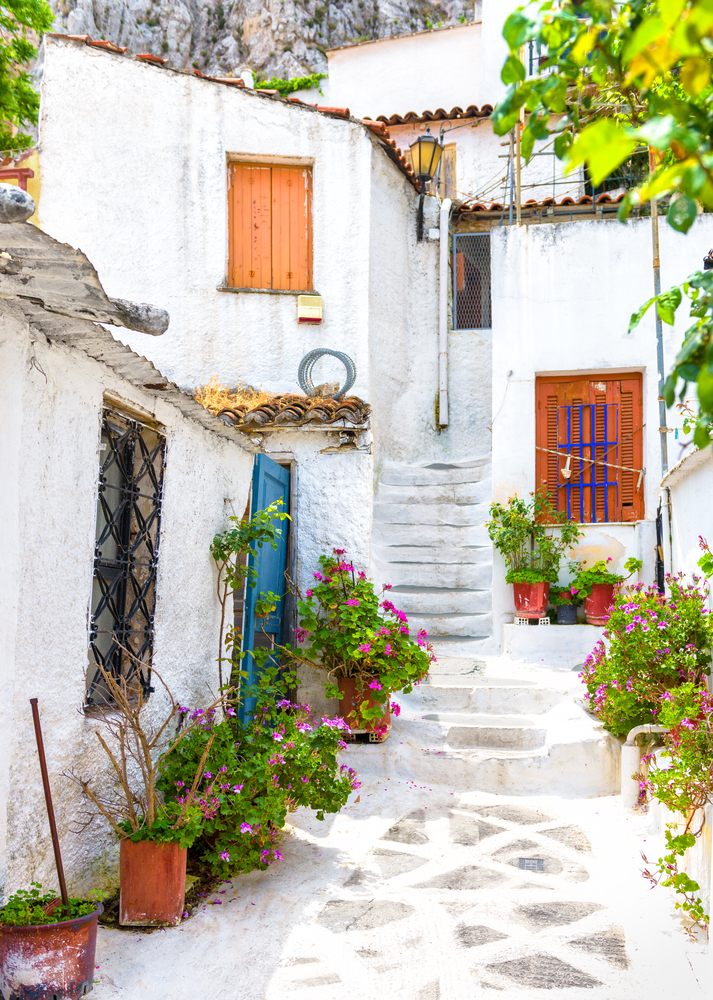 Old,Narrow,Street,With,Flowers,In,Anafiotika,,Plaka,District,,Athens,