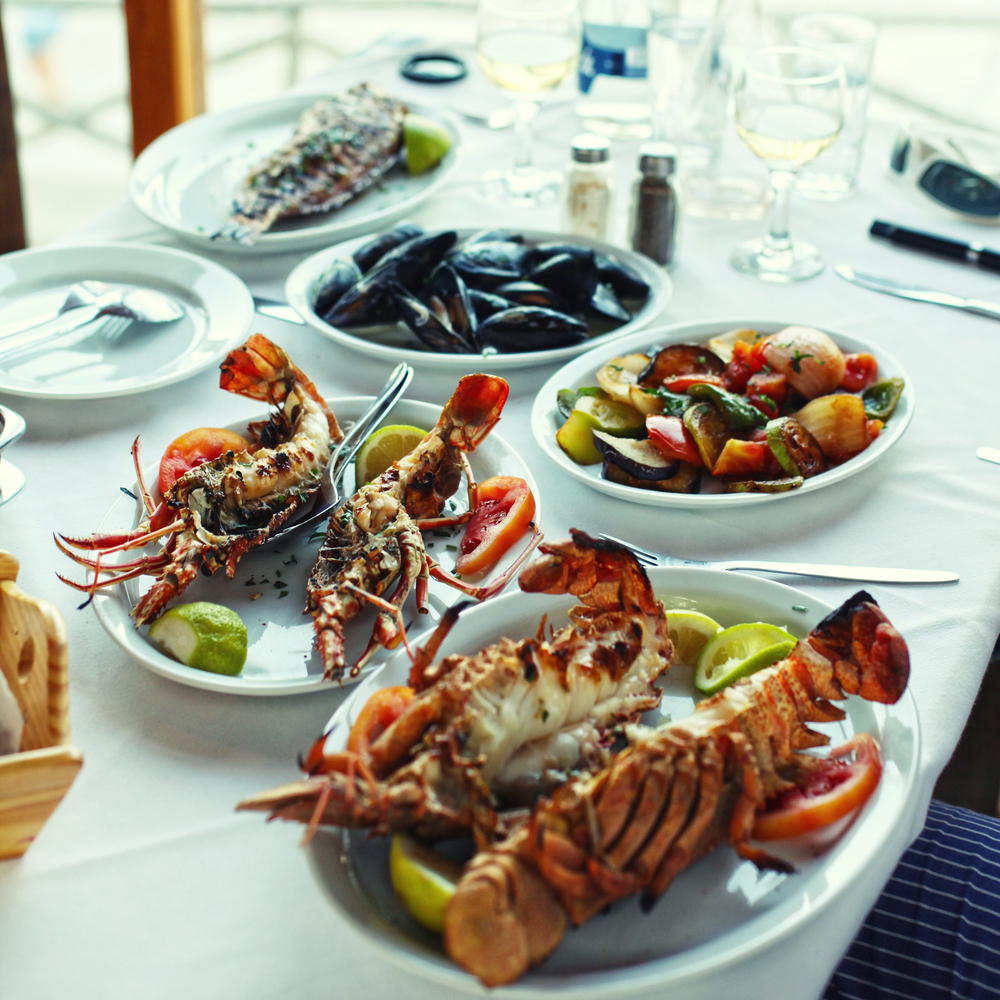 Lobster,And,Vegetables,An,The,Table,In,Typical,Greek,Taverna,