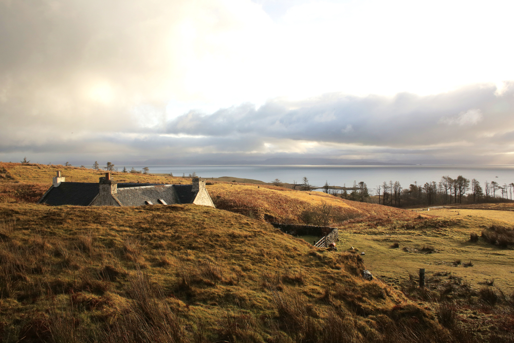 A,House,On,Landscape,Of,Isle,Of,Eigg,In,Scotland