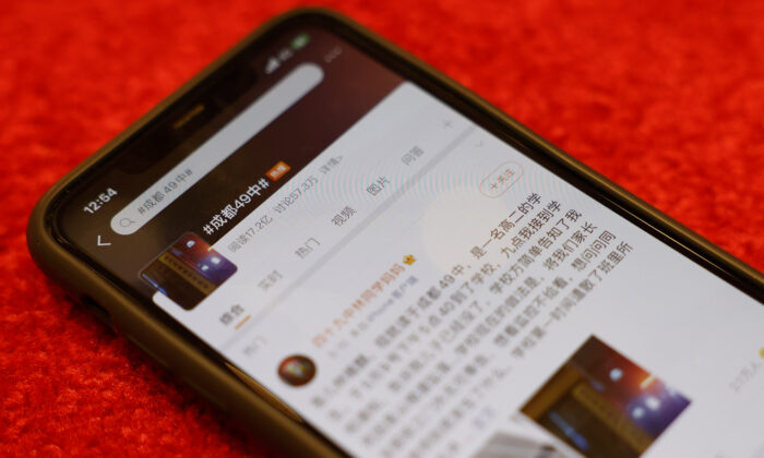 A Weibo page about the death of a student in Chengdu with 1.72 billion views is displayed on a mobile phone in Beijing, China, on May 13, 2021. (Ng Han Guan/AP Photo)