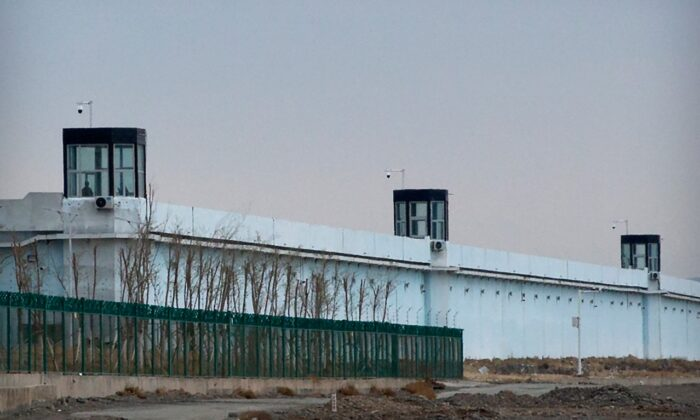 A person stands in a tower on the perimeter of the Number 3 Detention Center in Dabancheng in western China's Xinjiang Uyghur Autonomous Region, on April 23, 2021. (Mark Schiefelbein/AP Photo)