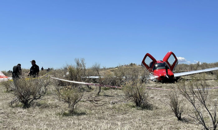 Officials at the scene of a plane crash where two small airplanes collide in midair near Denver, Colo., on May 12, 2021. (Arapahoe County Sheriff's Office)