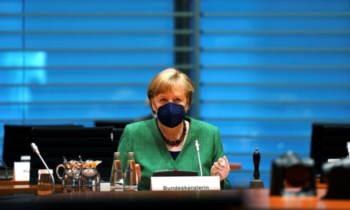 German Chancellor Angela Merkel arrives for the weekly cabinet meeting at the Chancellery in Berlin, Germany, on May 12, 2021. (Michael Sohn/Pool via Reuters)