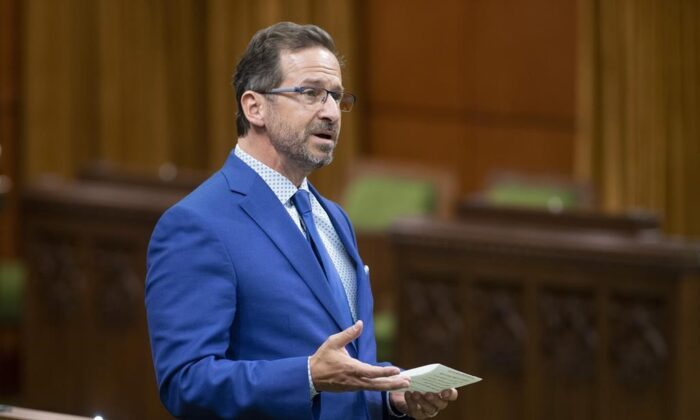 Bloc Quebecois Leader Yves-Francois Blanchet rises during Question Period in the House of Commons, in Ottawa, on May 13, 2021. Blanchet says he sees an opening to hold the next federal election on Aug. 16 if the pandemic is under control.  (Adrian Wyld / The Canadian Press)