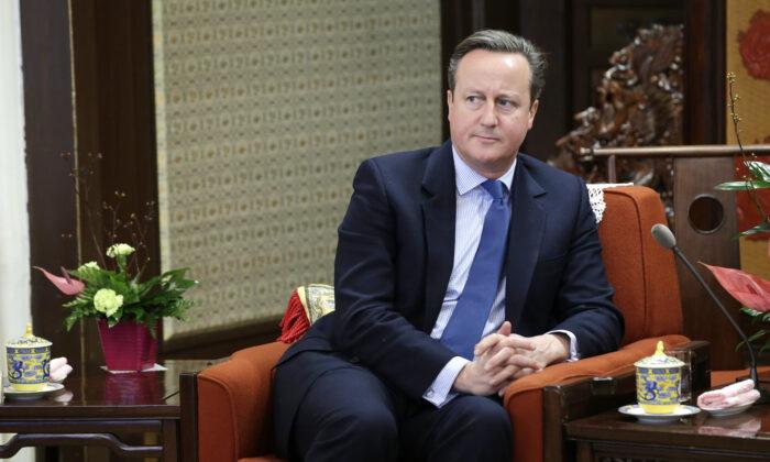 Former British Prime Minister David Cameron meets China's Premier Li Keqiang at Zhongnanhai leadership compound, in Beijing, China, on Nov. 27, 2018. (Jason Lee/Pool Photo via AP)