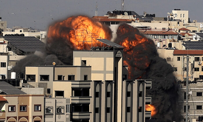 A picture shows the explosion after an Israeli strike targeted a building in Gaza City, on May 14, 2021. (Mahmud Hams/AFP via Getty Images)