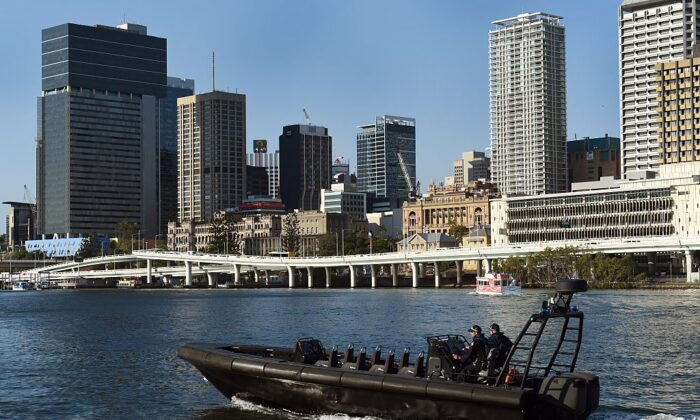A police boat patrols the river bordering the Southbank precinct in Brisbane, Australia on November 14, 2014.  (William West/AFP via Getty Images)
