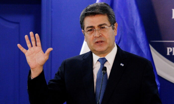 Honduras' President Juan Orlando Hernandez speaks during a joint message with U.S. Department of Homeland Security (DHS) acting Secretary Chad Wolf (not pictured), at the Presidential House in Tegucigalpa, Honduras, on Jan. 9, 2020. (Jorge Cabrera/Reuters)