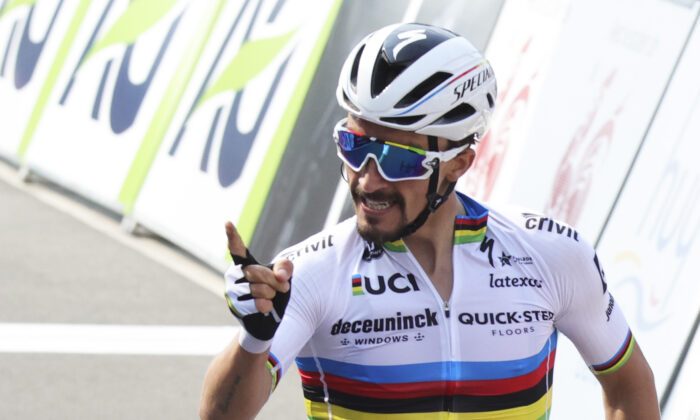 France's Julian Alaphilippe of the Deceuninck Quick-Step team crosses the finish line to win the Belgian cycling classic and UCI World Tour race Fleche Wallonne, in Huy, Belgium on Wednesday, April 21, 2021. (Olivier Matthys/AP Photo)