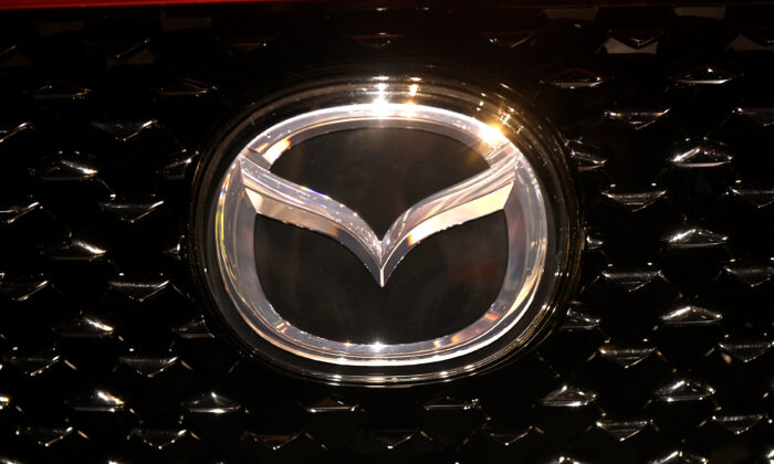 The logo of Mazda is pictured at the LA Auto Show in Los Angeles, California, U.S., November 20, 2019. (Andrew Cullen/Reuters)