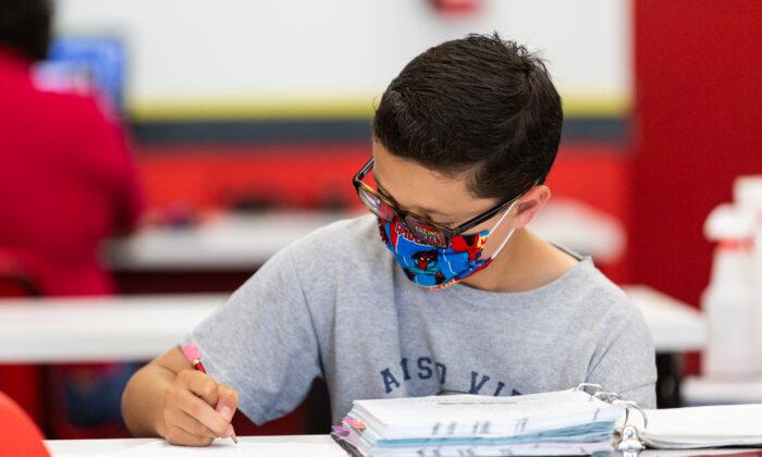 Student Nikolas Hoaen performs a math assignment at Mathnasium, in Laguna Niguel, Calif., on May 12, 2021. (John Fredricks/The Epoch Times)