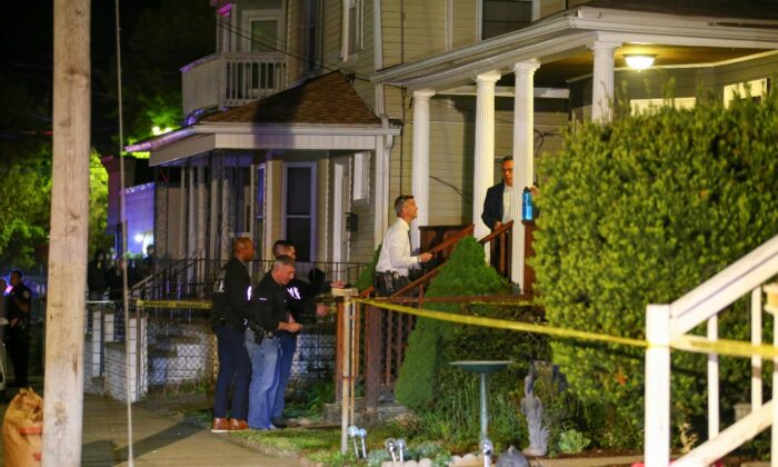 Providence Police investigate a shooting on Carolina Avenue, late Thursday, in Providence, R.I., on May 13, 2021. (Stew Milne/AP Photo)
