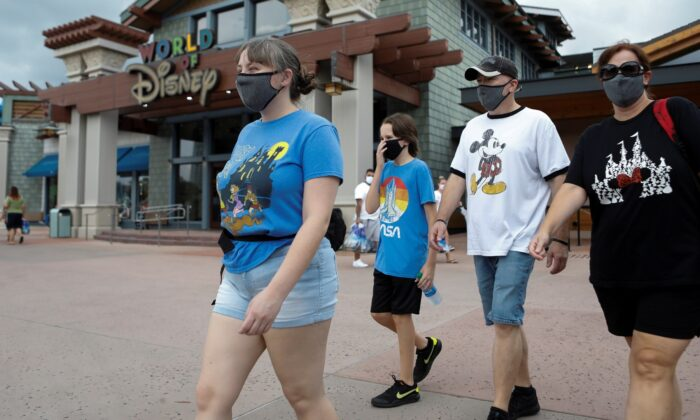 Summer Selmon, her brother Levi, and their parents Dave and Brandi wear masks while visiting the Disney Springs shopping and dining district during their vacation at Walt Disney World during a phased reopening from coronavirus disease  restrictions in Lake Buena Vista, Fla., on July 11, 2020. (Octavio Jones/Reuters)
