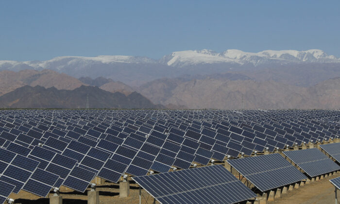 Large solar panels are seen in a solar power plant in Hami, northwest China's Xinjiang Uyghur Autonomous Region, on May 8, 2013. (STR/AFP via Getty Images)