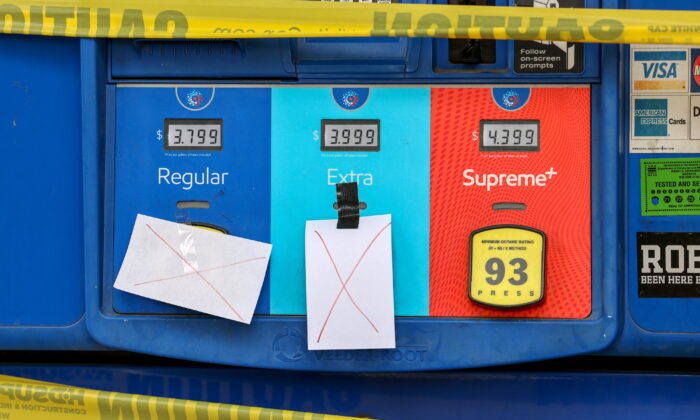 Gas pumps are roped off with a tape indicating a lack of gasoline at a gas station in Washington, on May 14, 2021. (Evelyn Hockstein/Reuters)