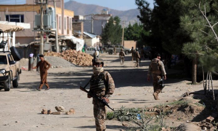 Afghan security personnel arrive at the site of a bomb explosion in Shakar Dara district of Kabul, Afghanistan, on May 14, 2021. (Rahmat Gul/AP Photo)