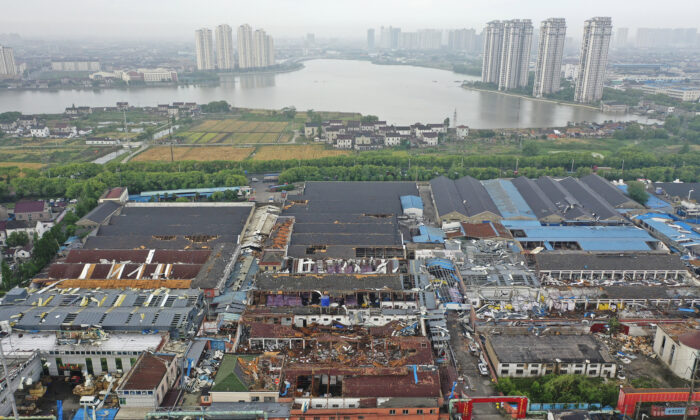 Damage to buildings from a reported tornado is seen in an aerial view in Shengze township in Suzhou in eastern China's Jiangsu Province, China, on May 15, 2021. (Chinatopix via AP)