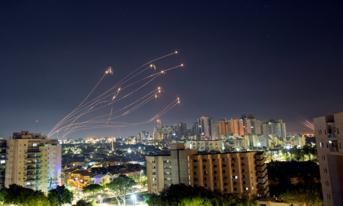 Streaks of light are seen from Ashkelon as Israel's Iron Dome anti-missile system intercepts rockets launched from the Gaza Strip towards Israel on May 15, 2021. (Amir Cohen/Reuters)