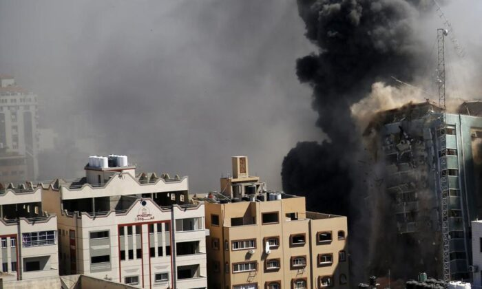 An 11-story building housing the AP office and other media in Gaza City, moments after Israeli warplanes demolished it, on May 15, 2021. (Hatem Moussa/AP Photo).