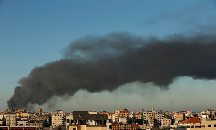 Smoke rises amid a flare-up of Israeli–Palestinian conflict, in Gaza, on May 15, 2021. (Suhaib Salem/Reuters)