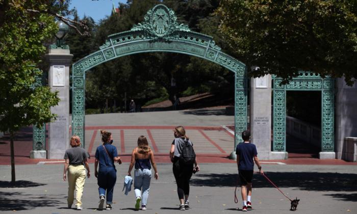 People walk toward Sather Gate on the U.C. Berkeley campus in Berkeley, California, on July 22, 2020. (Justin Sullivan/Getty Images)