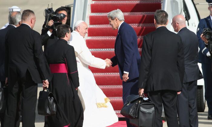 Pope Francis bids farewell to then-Secretary of State John Kerry as he departs from Washington en route to New York City in Joint Base Andrews, Maryland on Sept. 24, 2015. (Patrick Smith/Getty Images)