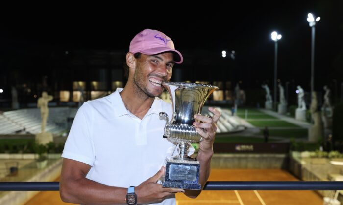 Rafael Nadal of Spain celebrates with the trophy after winning the final over Novak Djokovic of Serbia during the men's final at Foro Italico in Rome, Italy, on May 16, 2021. (Clive Brunskill/Getty Images)